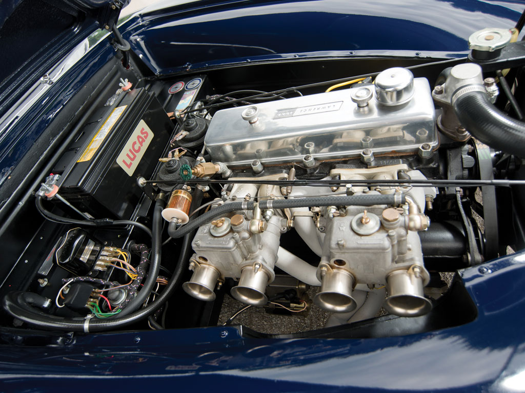 The two litre pushrod engine with twin dual throat carburettors that look like pipes from an English countryside church organ.