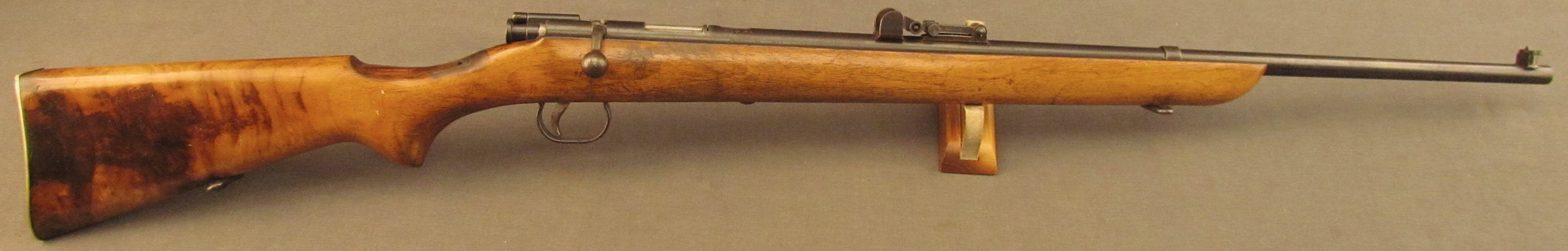 BSA single shot rifle similar to the one we used for our home shooting range. You will find this one for sale  at https://www.joesalter.com/category/products/BSA-War-Office-Military-22-Rifle