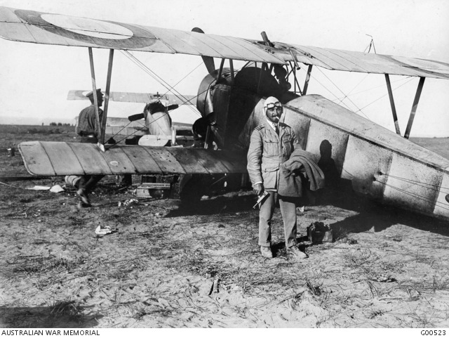 Commander C R Samson of the 3rd Squadron Royal Naval Air Service Wing in the Dardanelles campaign of World War I, seen here with his Neuport 10 aircraft and Webley and Scott automatic pistol.