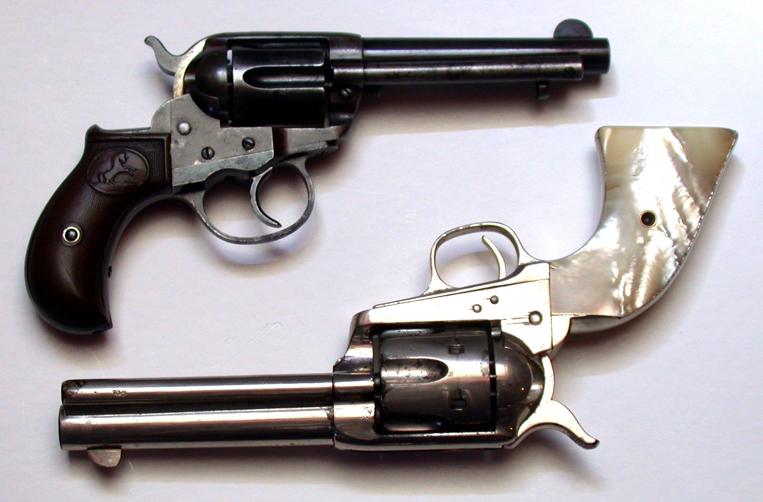 Colt 1877 compared with a contemporary Colt Single Action.