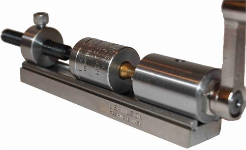 The Wilson Case Trimmer; here you can see the cartridge case held by the body fully centered and supported.