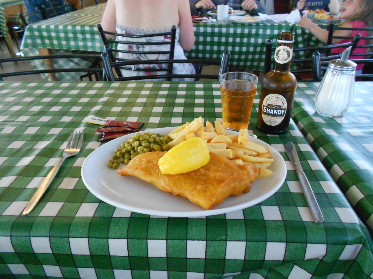 Fish and Chips with a Shandy. You won't find a more British seaside lunch than this.