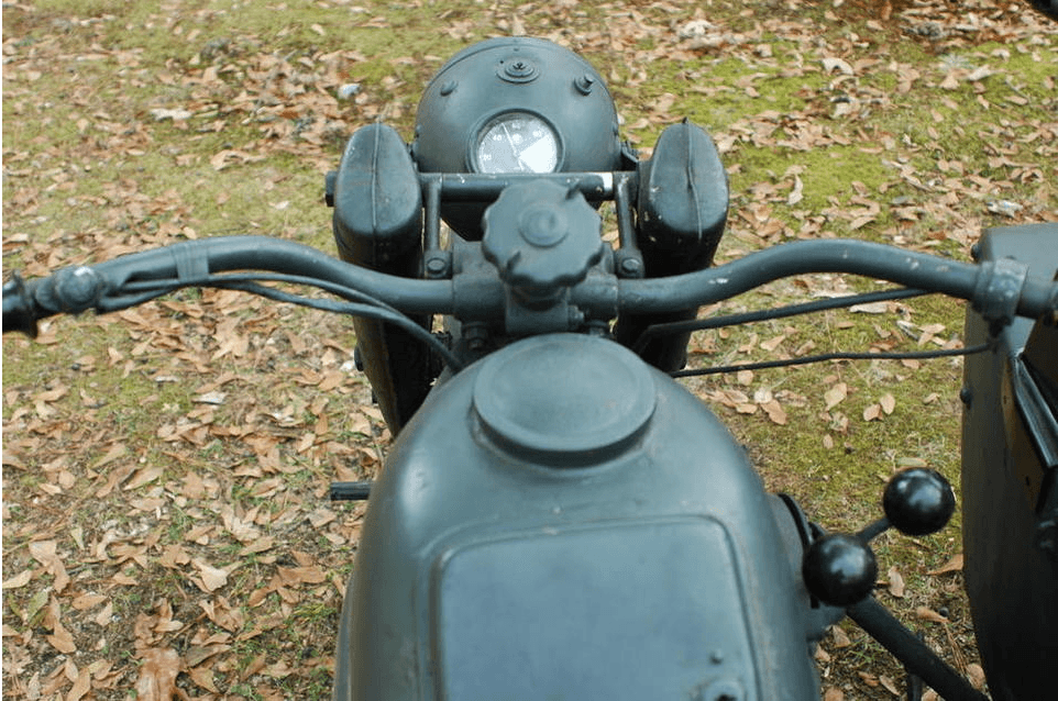 The driver's eye view of the Zundapp. Which would be more fun, to drive or to sit in the sidecar and shoot? Life is full of tough choices.