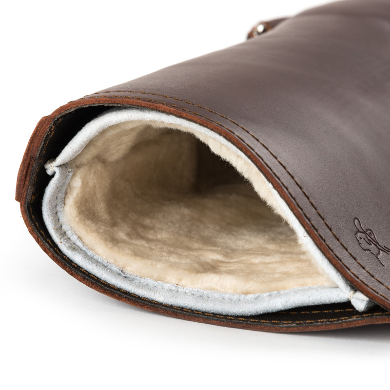Removable and washable sheepskin liner in the gun or rifle sheath.