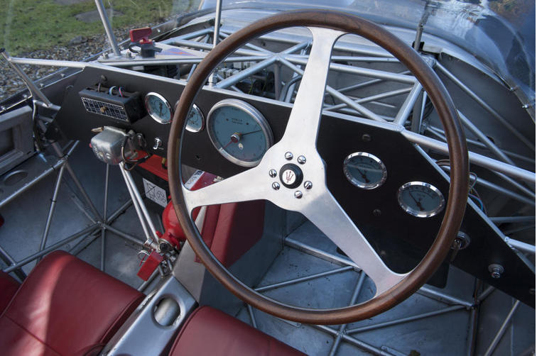 The cockpit of the Maserati Tipo 60/61 is an austere delight with the driver ensconced in a sea of complex tubing.