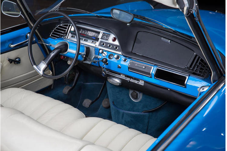 The romantic interior of the Citroen DS showing the single spoke steering wheel to help the driver see the instrumentation easily and thus keep his mind on his driving, and the convenient location of the gear control.