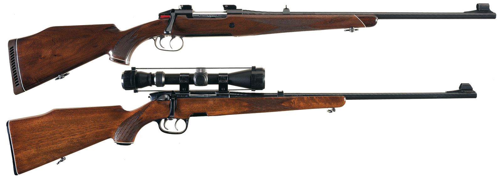 Top rifle is a The Mannlicher Schönauer M72, lower rifle is a Steyr-Mannlicher of the seventies with its plastic fittings. The The Mannlicher Schönauer M72 as you can see is a graceful blending of blued steel and walnut: the Steyr Mannlicher is a blend of blued steel, walnut and plastic that becomes one of the ugliest sporting rifles in existence.