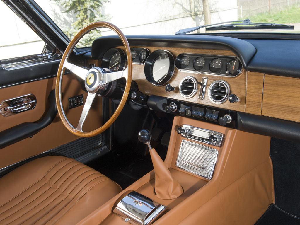 The interior of the 330 GT 2+2 is a tastefully restrained blending of leather and timber.