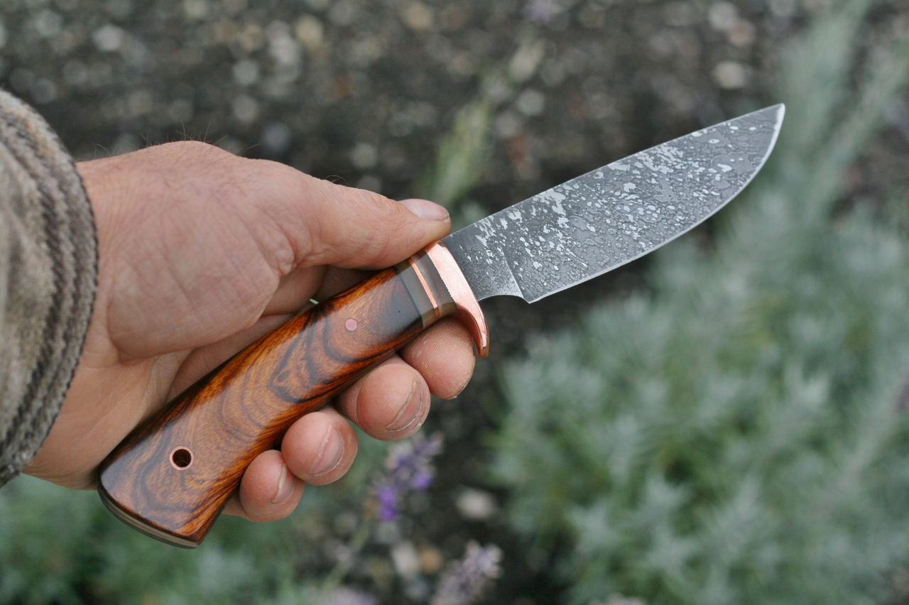 The Custom drop point hunting knife with  ironwood grip. Graceful lines in a functional package.