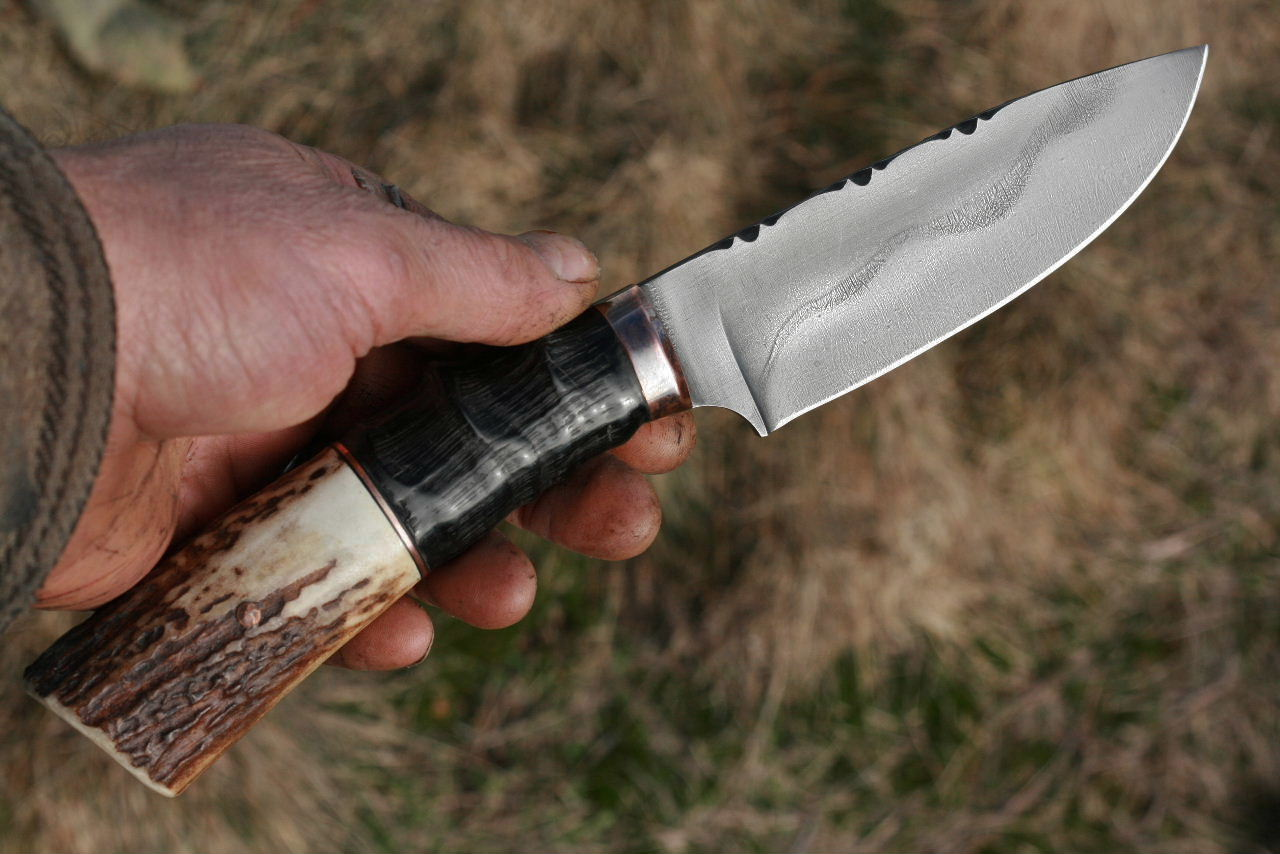 The C Thomas Custom Large Hunter in African antelope and elk antler. Just the right size and with the most subtle dropped point so you can extend your forefinger along the top of the blade for fine control. It looks a near perfect design to me.