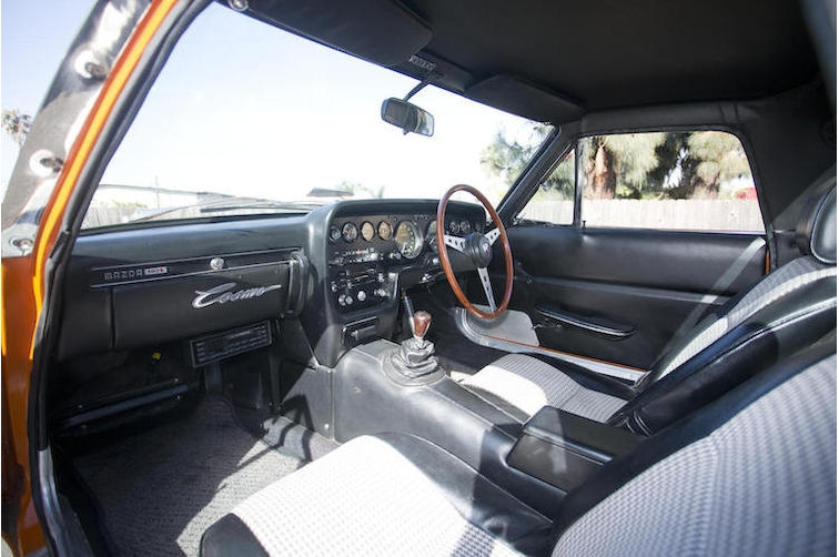 The interior of the Mazda 110S Cosmo is all sports car. Modelled after the sports and GT cars of the sixties it is tasteful and restrained.