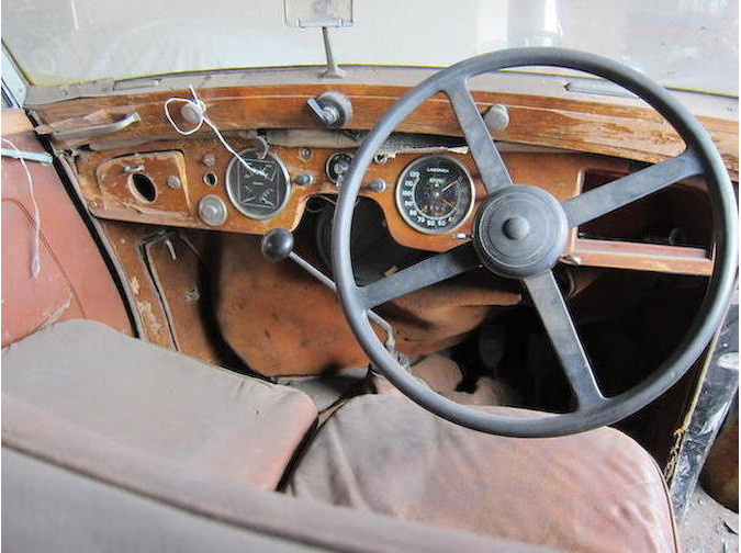 The driver's view of the big Lagonda. Instrumentation is adequate, the steering wheel is classic, and the handbrake is located in the preferred location for British cars of the period to the right of the driver's seat.