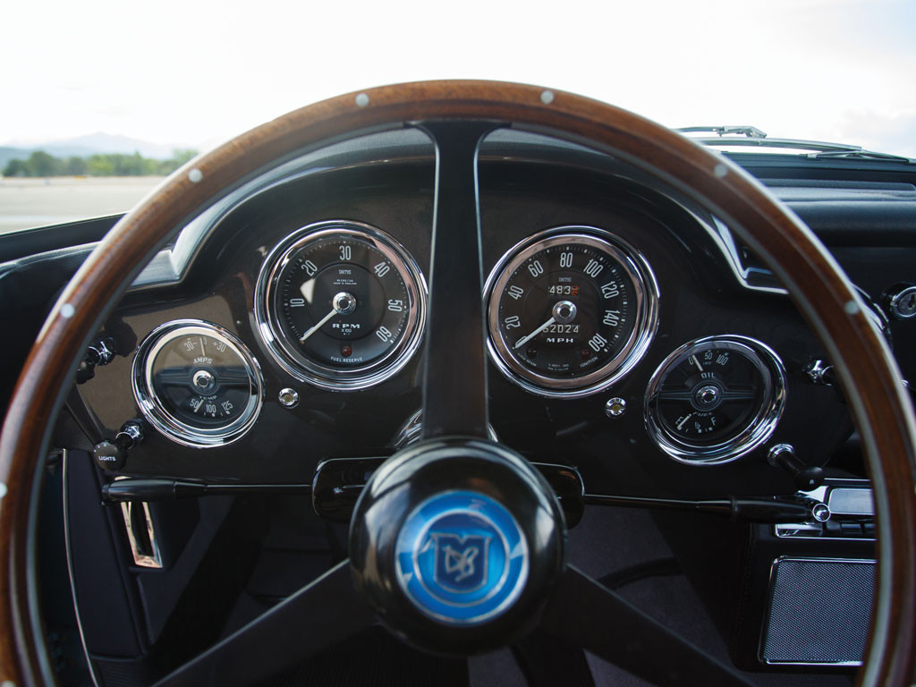 Classic Aston Martin instrument layout, everything visible in the driver's direct line of sight.