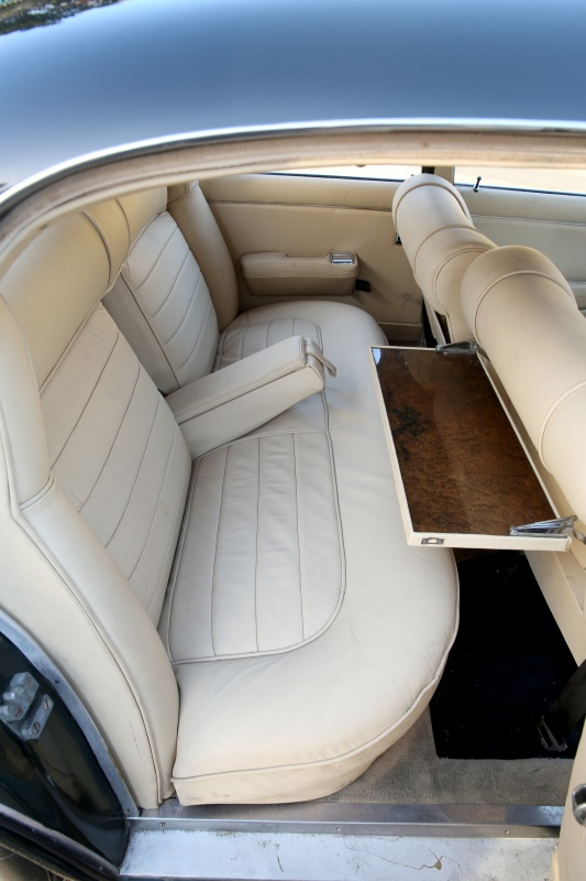 The folding tables fitted into the rear of the front seats are nowadays useful for iPads and Android tablets for personal entertainment. In the sixties however we just had books and magazines. (Picture courtesy of classicdriver.com)