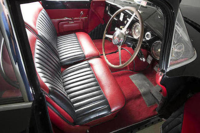 The interior of the restored Antem bodied Type 101C is in a tasteful red and black that compliments the car's paintwork beautifully.