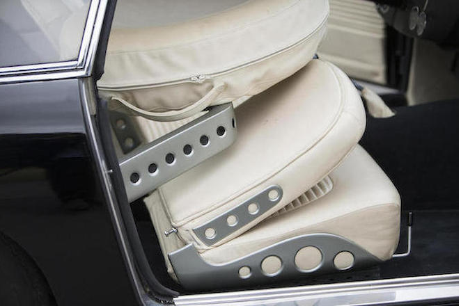 The spare wheel is mounted on a movable frame that can be brought forward for convenient access when the front seats are folded forward.