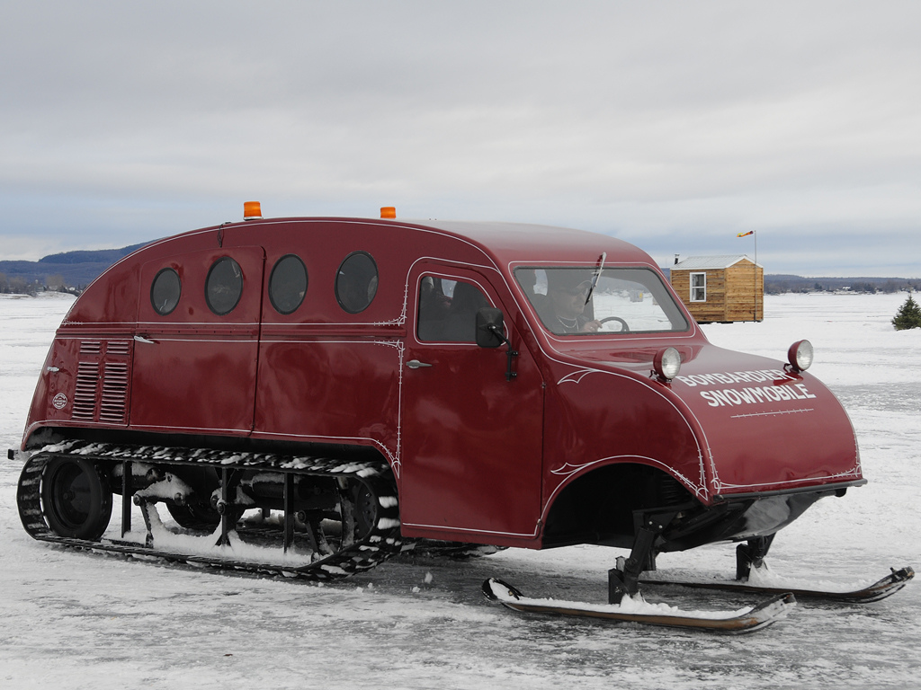 The traditional porthole shaped windows used on the wooden bodied Bombardier Snowmobiles were intended to provide strength in severe weather conditions. (Picture courtesy Flickr.com)