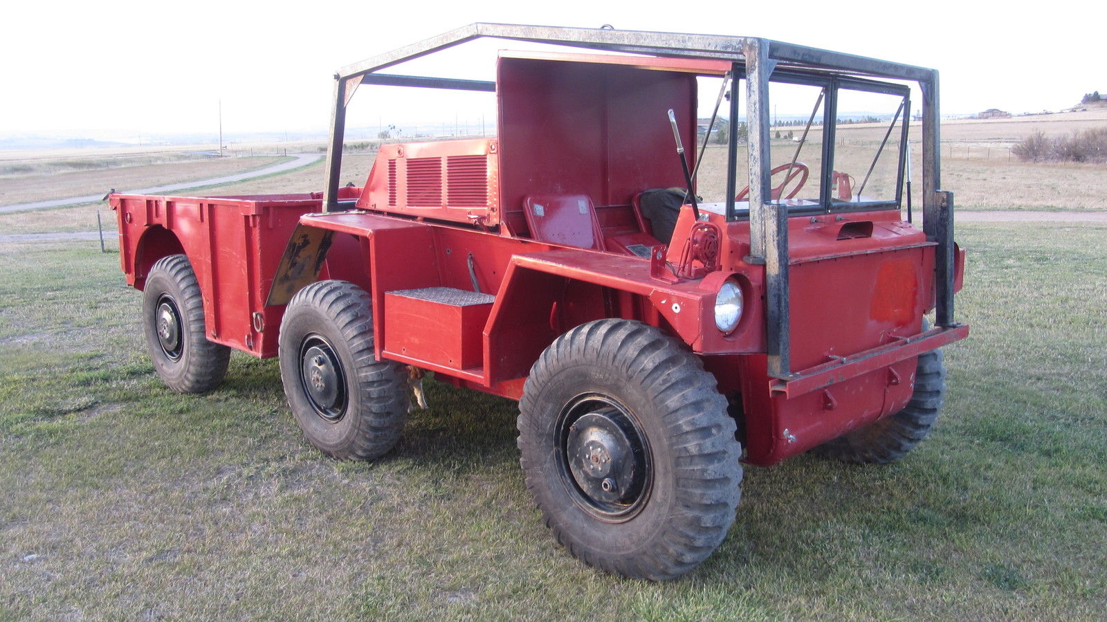 "The Gama Goat recently offered for sale on eBay. The vehicle has been painted bright ""fire engine"" red, presumably to make it easier to find should the operator forget to close the drain plugs before swimming it. (Picture courtesy eBay)."