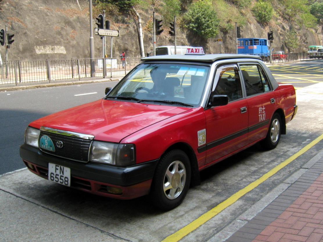 Yes this taxi can legally carry five passengers plus the driver. It has a front bench seat and seatbelts for all six people. (Picture courtesy Wikipedia).