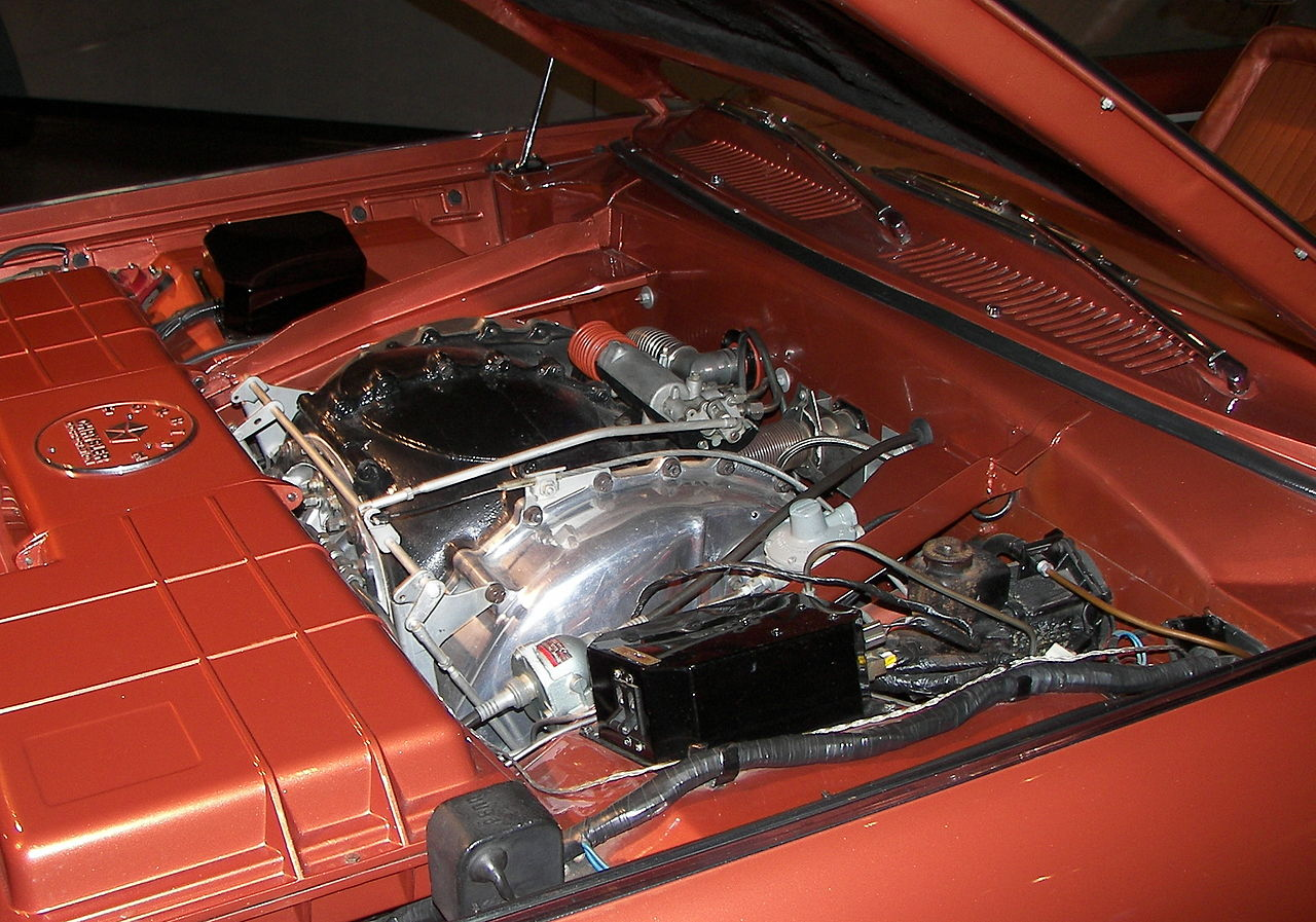 Can anything be more impressive than opening the hood of a car and seeing a huge supercharged V8? Yes, this is the sight that greets you when you open the hood of the Chrysler gas turbine. (Picture courtesy Wikipedia).