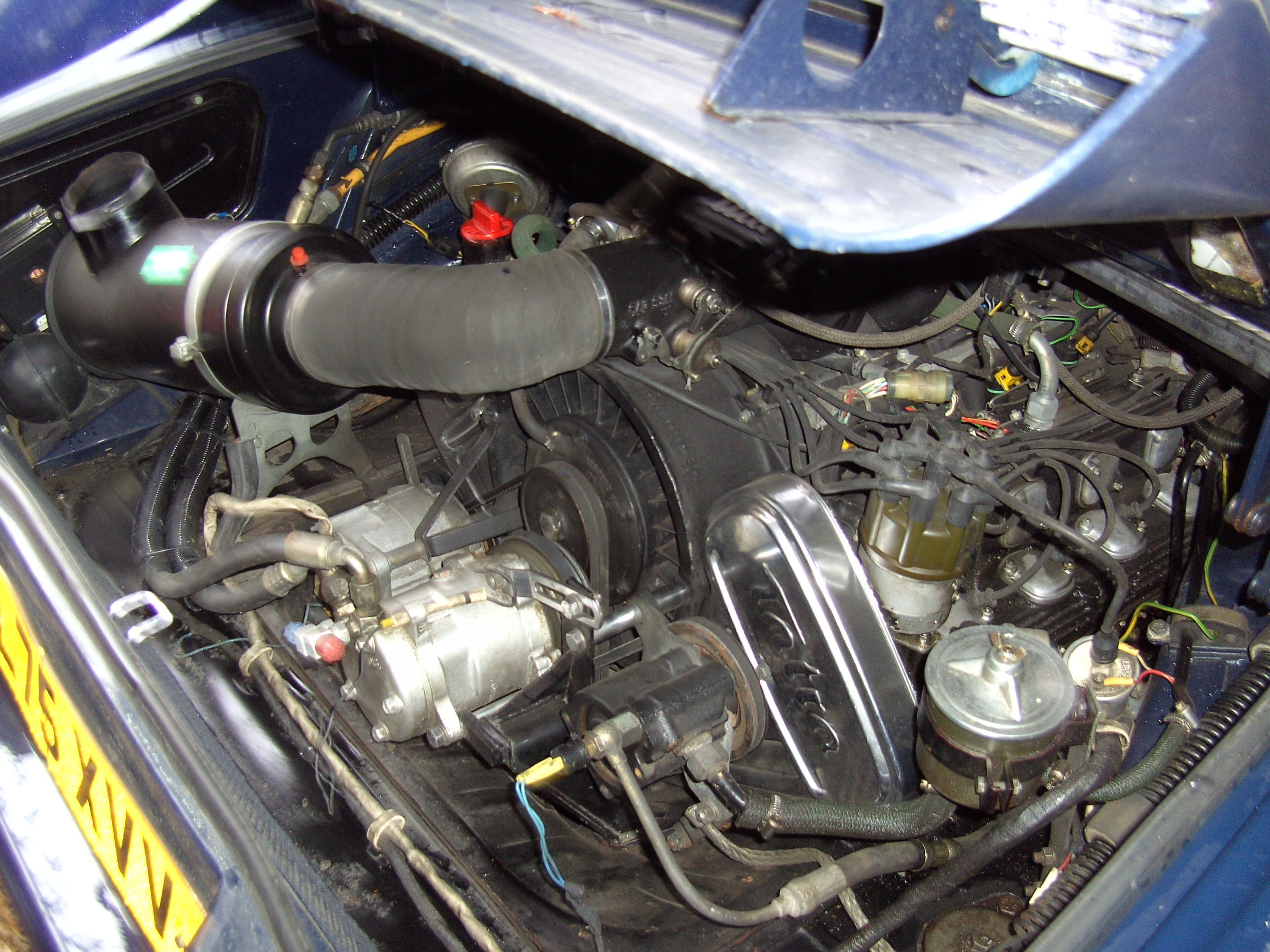 Opening the engine bay of a Tatra 613 can be a bit of a jaw dropping experience. Nonetheless that alloy air cooled V8 is well positioned in the car. It's a layout that is imaginative and effective. (Picture courtesy davydutchy at Flickr)