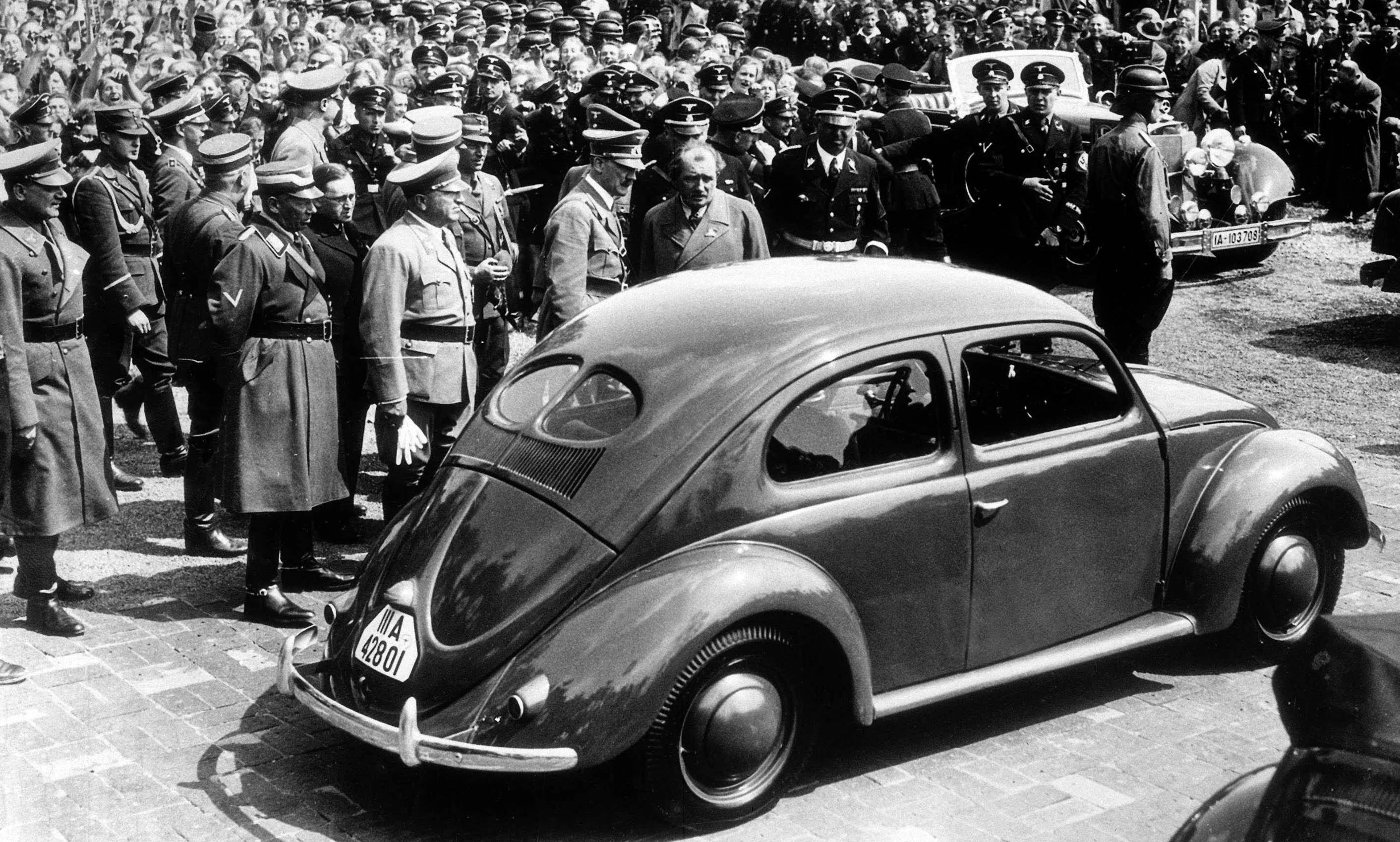 Adolf Hitler with the Volkswagen's designer, Dr Ferdinand Porsche, at the Volkswagen factory in 1938 - the same year Hitler was awarded Time Magazine's Man of the Year Award.