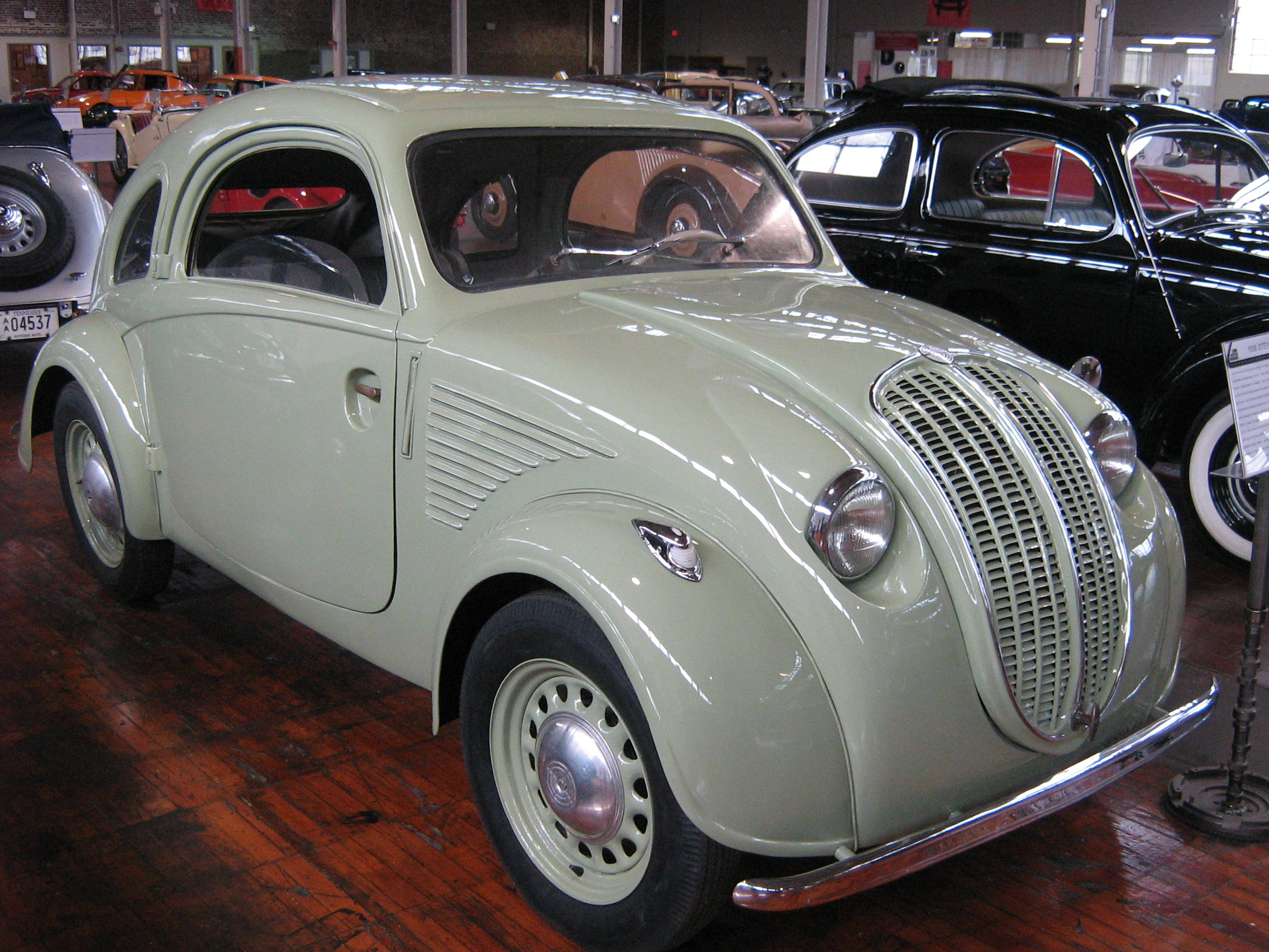 "The 1936 Austrian Steyr 50 ""Baby"", with a Volkswagen in the background. (Picture courtesy wikimedia.org)"