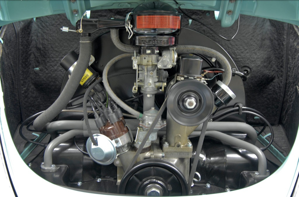 The engine of the Volkswagen is kept highly accessible despite its being a horizontally opposed low mounted unit. Carburettor, air cleaner, distributor, ignition coil, fan belt all easy to maintain. (Picture courtesy conceptcarz.com)