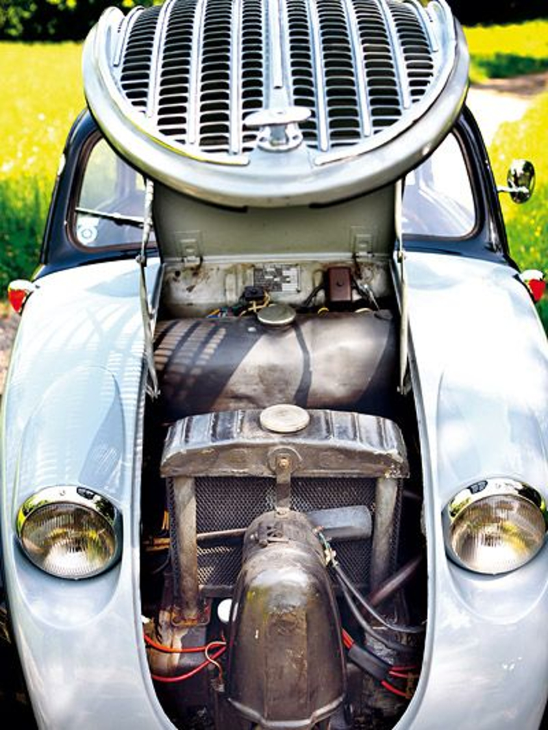 The engine layout of the Steyr is unusual. The radiator sits above the horizontally opposed four cylinder engine. The distributor sits behind the housing in front of the radiator. (Picture courtesy Pinterest)