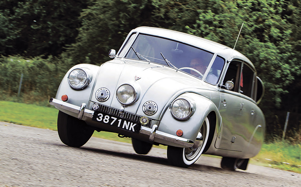 A Tatra T87 under hard cornering with the combined effects of the rear mounted alloy V8 engine and swing axles being apparent. (Picture courtesy drive-my.com)