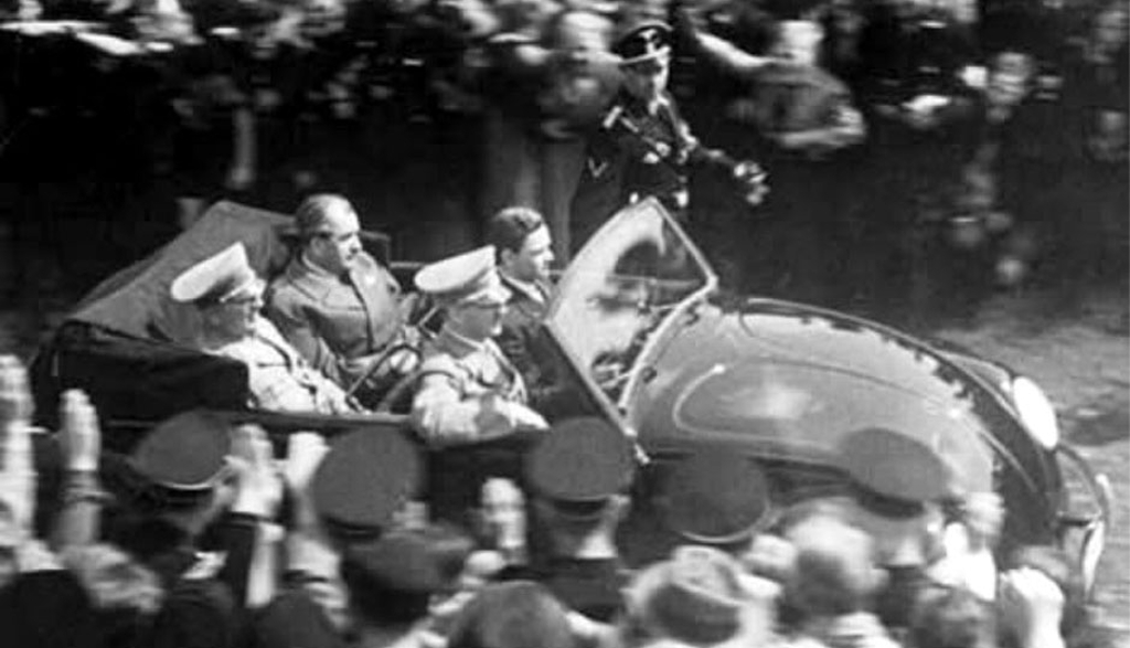 In the back seat are a tense looking Dr. Ferdinand Porsche with a relaxed Robert Ley, the head of the Nazi Labour organization Deutsche Arbeitsfront, (DAF). In the front seat a contented looking Adolf Hitler and a nervous looking Ferry Porsche, Ferdinand Porsche's son. (Picture courtesy stuttcars.com)