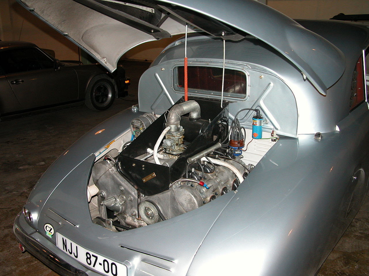 The rear mounted alloy V8 engine of the Tatra T87 is a more impressive sight than one gets when opening the engine bay of a Volkswagen. This car is in the Lane Motor Museum. (Picture courtesy wikimedia).