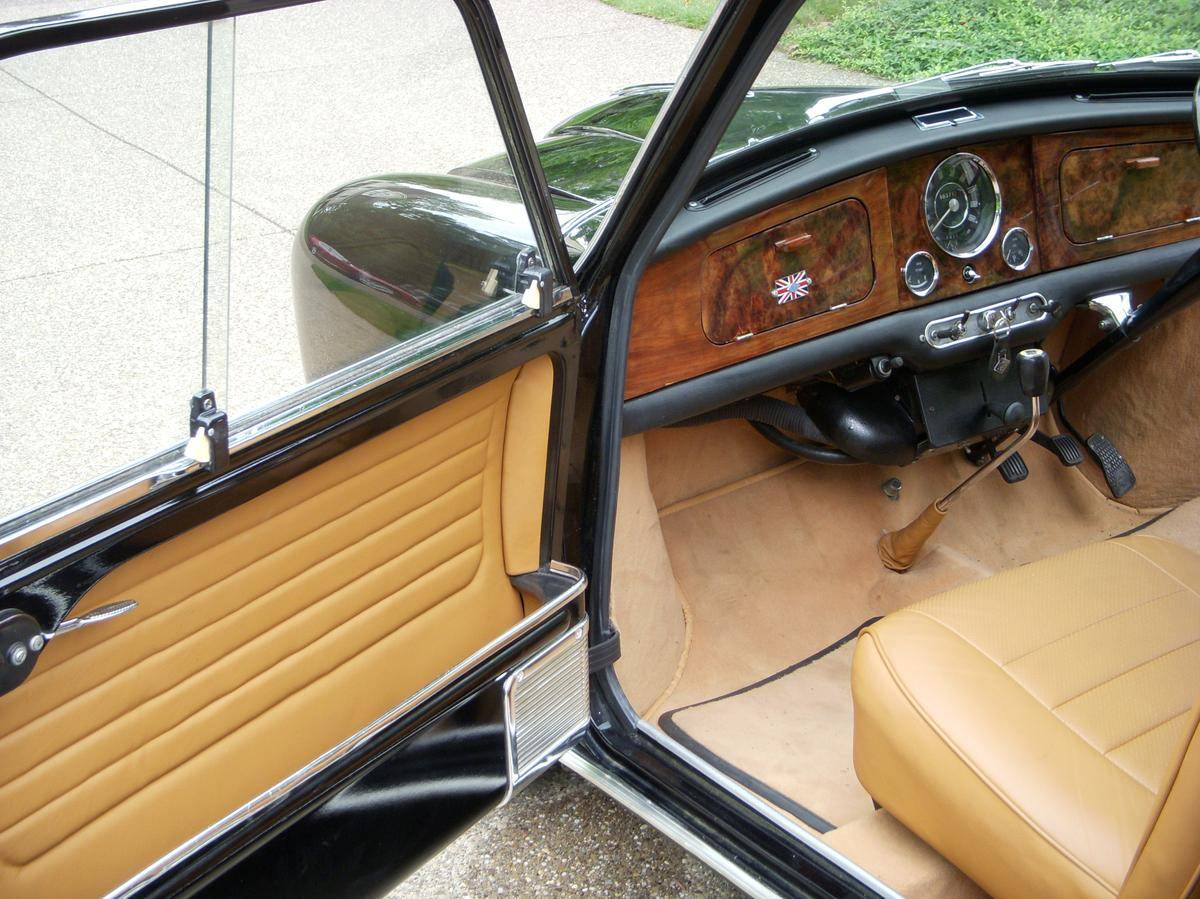 The wood veneer dashboard with upgraded Smiths instrumentation, carpets and leather trim make the Riley Elf stand out as a small but prestigious car. (Picture courtesy Hemmings).