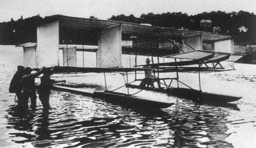 Gabriel Voisin in the aircraft in which he made his historic flight in 1905. (Picture courtesy fly.historicwings.com).