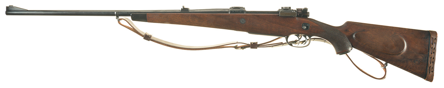 The rifle has an unusual safety catch located on the left side of the stock above the trigger. (Picture courtesy Rock Island Auction).