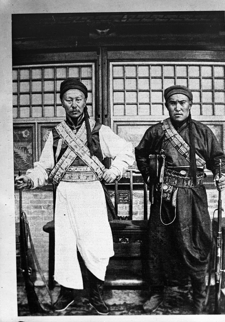 Armed Chinese, the gentleman on the right has a Mauser C96 in the wooden holster that doubled as an attachable shoulder stock. (Picture courtesy the British Library).