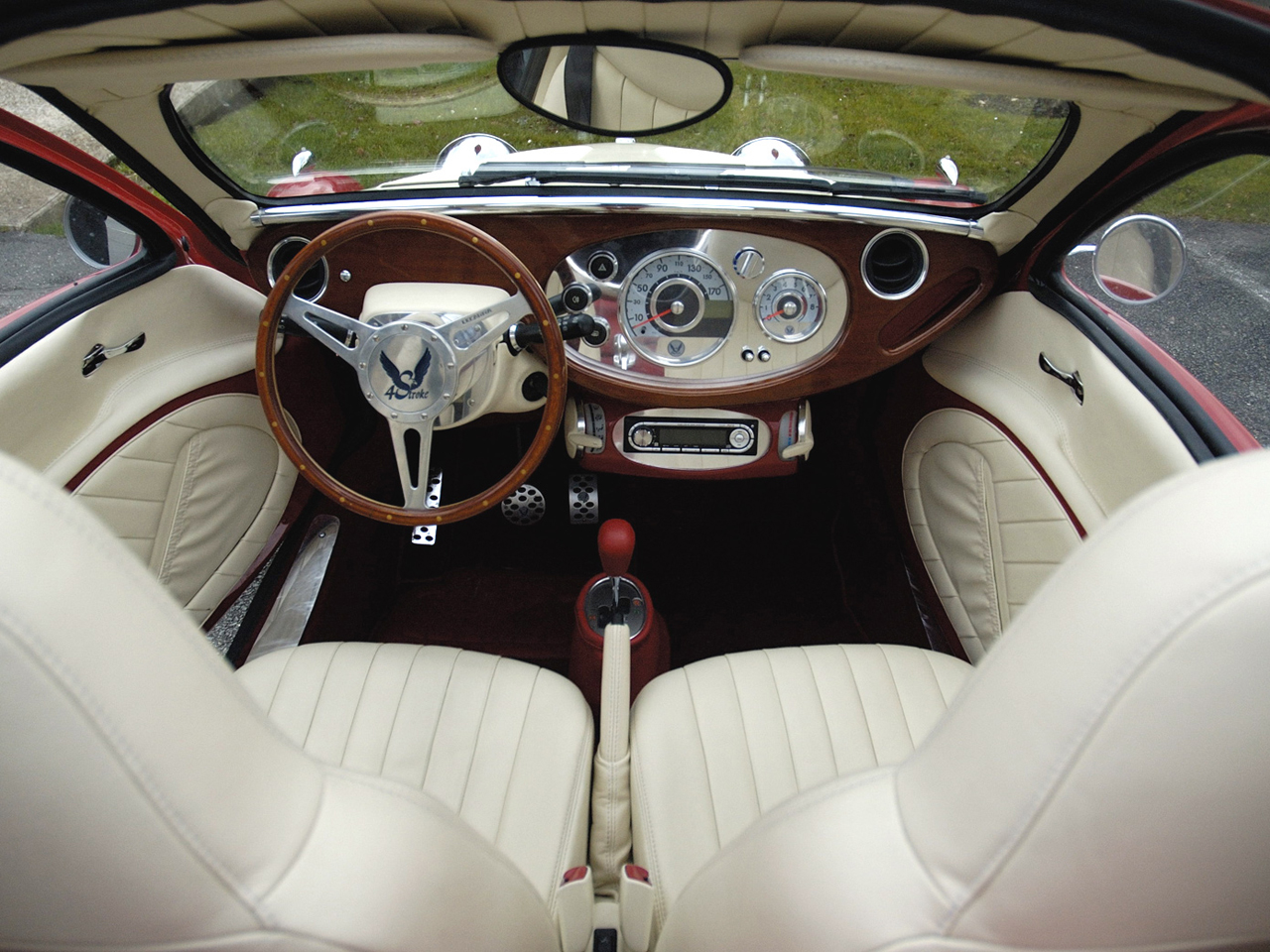 The cockpit of the 4 Stroke Rumen is a clever mixing of thirties style and 21st Century comforts, including air-conditioning. (Picture courtesy autowp.ru).