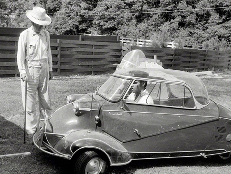 "Elvis Presley in 1956 at home in Memphis with his three-wheeled Messerschmitt ""bubble car"" and Harley-Davidson motorcycle [hidden behind], and grandfather Jessie Presley. (PIcture courtesy Shorpy Historical Photo Archive)."
