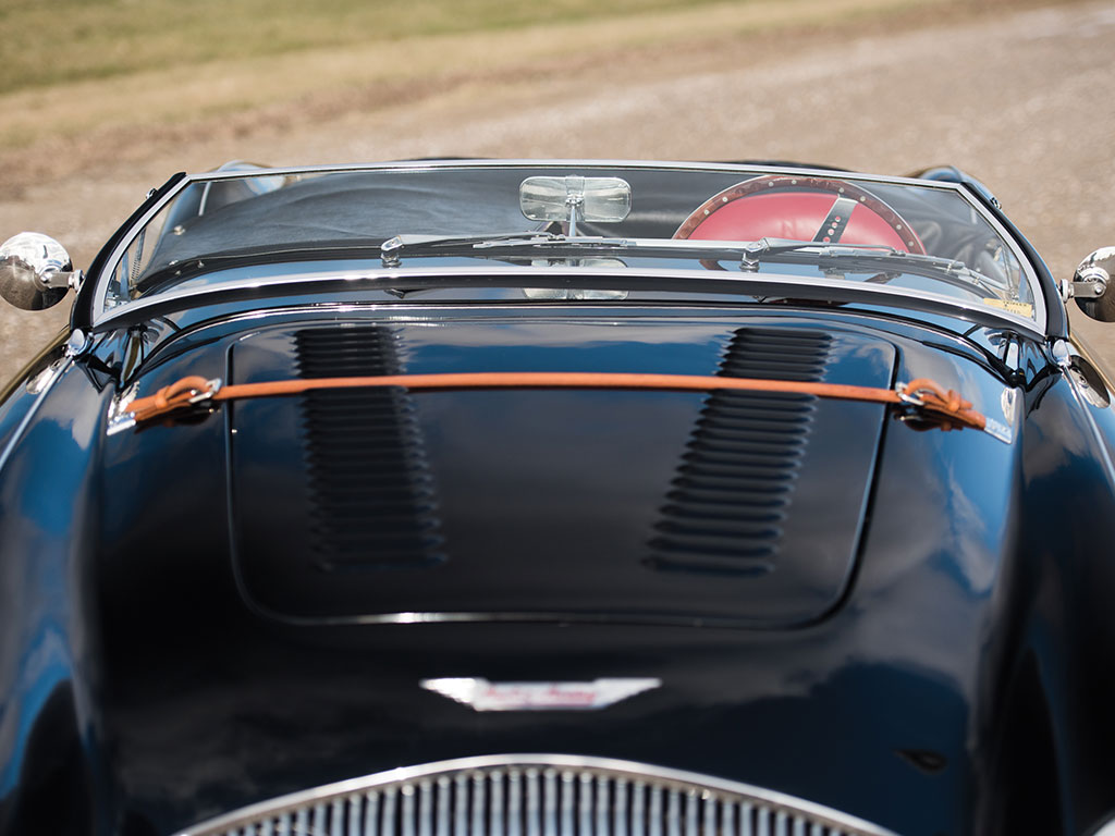The 100M comes with purposeful air vents on the hood and a leather strap to keep the hood down in case the hood latch comes loose. (Picture courtesy RM Sotherby's).