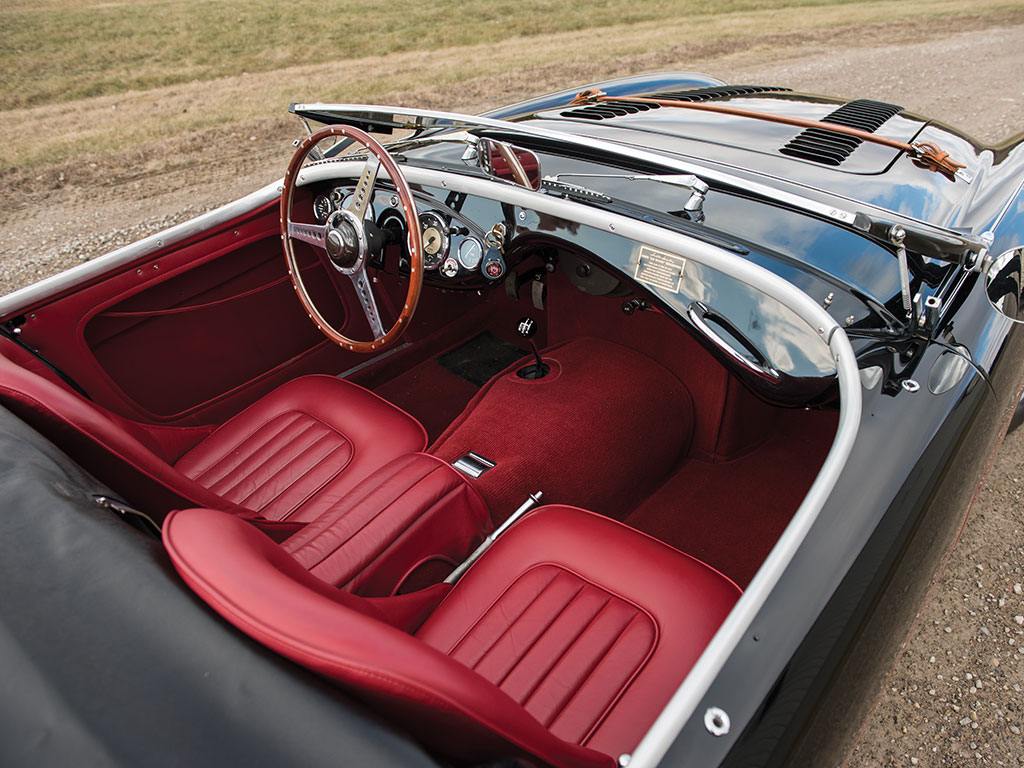 "Interior of the car is beautifully upholstered in red leather complimented by a wood rimmed ""banjo"" style steering wheel. (Picture courtesy RM Sotherby's)."