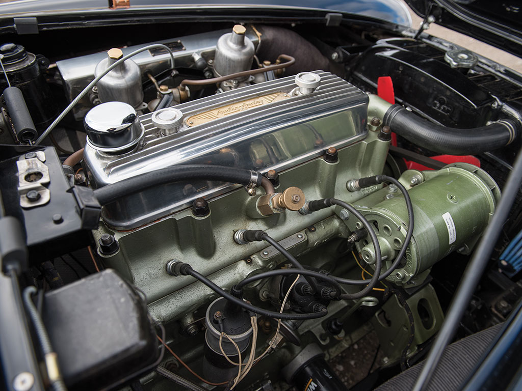 Engine improvements for the 100M included a free flow intake manifold with larger twin SU carburettors and a cold air box along with a high lift camshaft and high compression pistons. (Picture courtesy RM Sotherby's).
