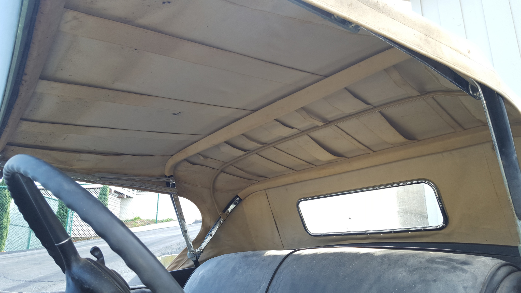 Interior of the convertible's roof cover is in good shape so the whole cover can be used as a pattern to create a new cover. (Picture courtesy bringatrailer.com).