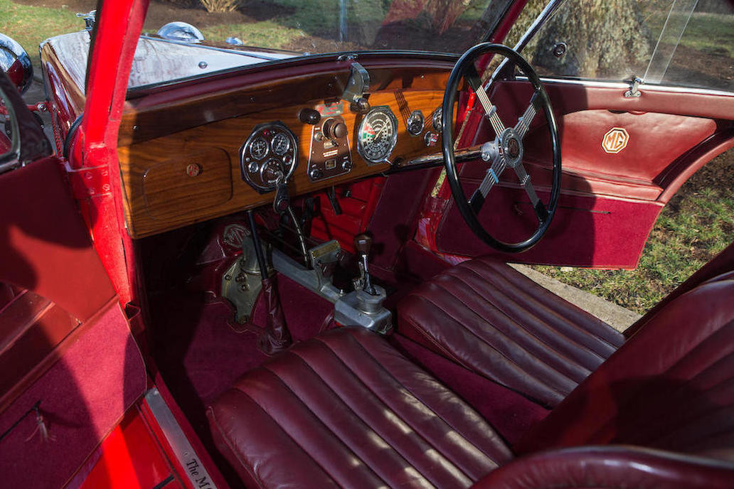 An enthusiast's interior. The mixing of luxurious wood for the dashboard and yet with the naked top of the gearbox visible is a curious mix of refinement and race track practicality. (Picture courtesy Bonhams).