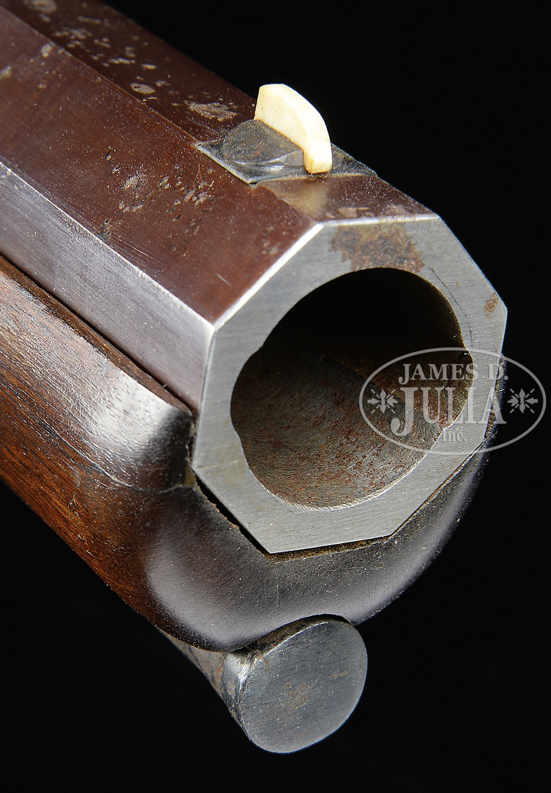 "The The E.M. Reilly Four Bore Belted Ball Percussion Rifle requires a ""belted ball"" shaped projectile that has protrusions that engage in the two grooves in the barrel. (Picture courtesy James D. Julia Inc.)."
