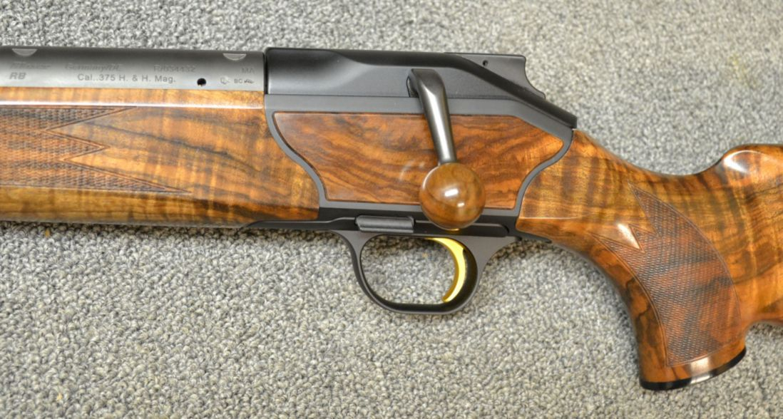 This Blaser R8 Safari not only features wood with astonishingly pretty grain and figure, but that wood makes it onto the bolt handle also. (Picture courtesy Cabela's).