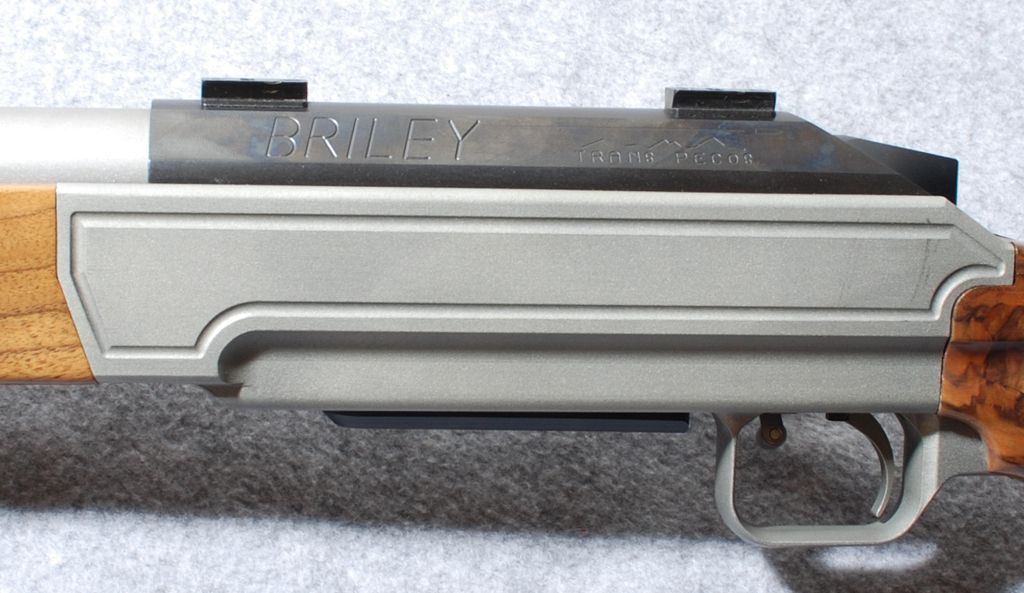 The rifle action bedded in an aluminium housing with the barrel free floating.