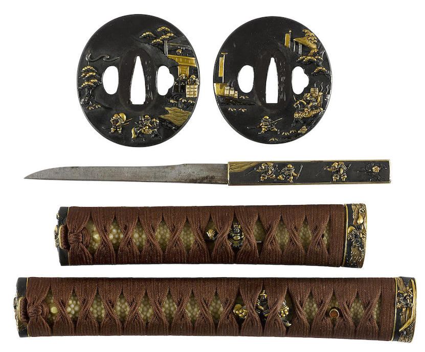 The scenes on the tsuba (hand guards), the small utility knife and on the tsuka (the hilts) feature scenes of warfare from the Genpai War. (Picture courtesy Bonhams).