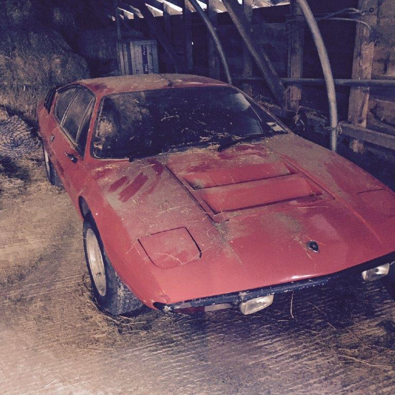 As originally found the car is covered in usual barn grime but looks straight and restorable.