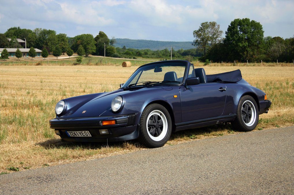 Porsche 911 Carrera Cabriolet. Note that the standard windscreen with quarter vents and standard soft top are likely more practical but certainly not as good looking. (Picture courtesy Wikipedia).