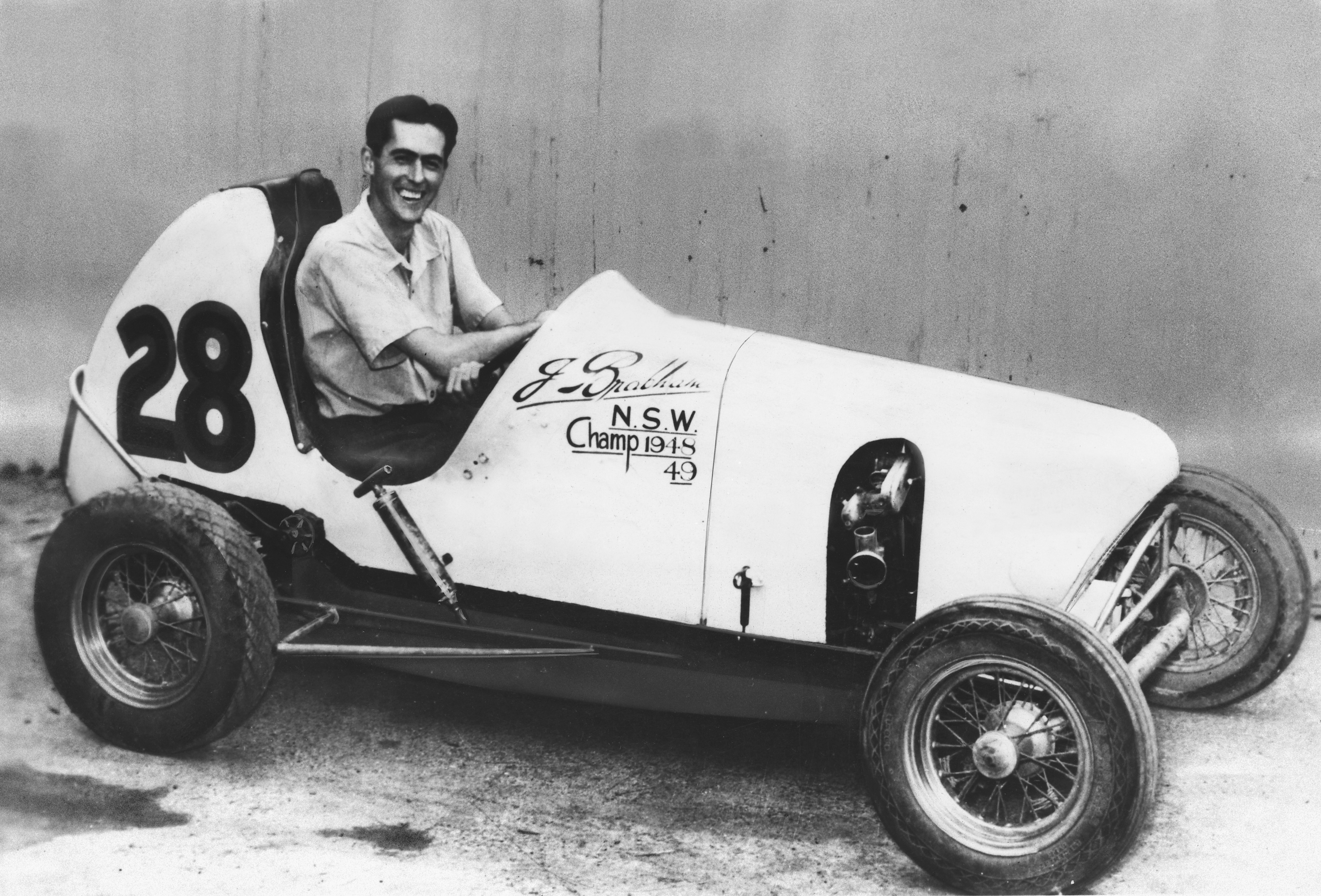 A young Jack Brabham in his Australian Speedcar having discovered that racing driving is fun. (Picture courtesy news.cision.com).